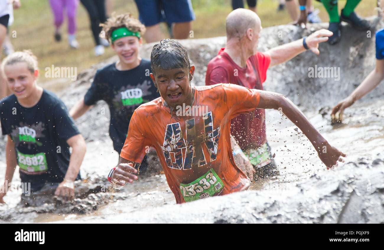 Toronto, Canada. 26th Aug, 2018. Participants take part in the 2018 Mud Hero Toronto North event at Albion Hills Conservation Area in Toronto, Canada, Aug. 26, 2018. Credit: Zou Zheng/Xinhua/Alamy Live News - Stock Image