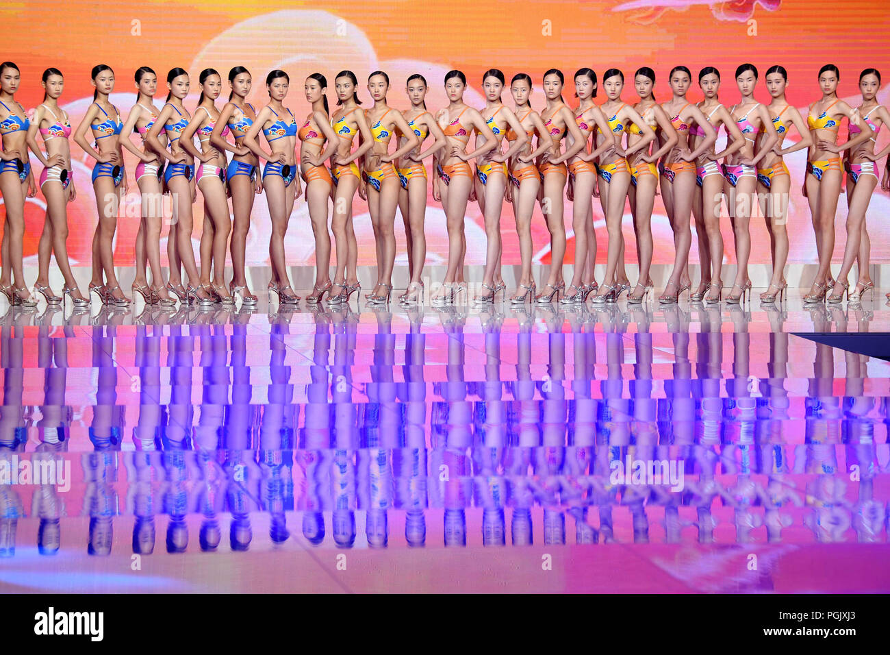 Qingdao, China's Shandong Province. 26th Aug, 2018. Contestants pose in the swimwear session during the 13th China Super Model Final Contest in Qingdao, east China's Shandong Province, Aug. 26, 2018. Credit: Li Ziheng/Xinhua/Alamy Live News - Stock Image