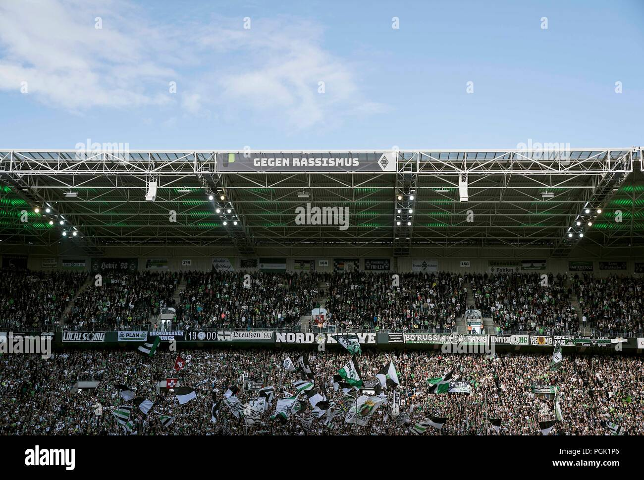 Feature, Fankurve MG with flags and flags, north curve, with a banner versus racism, Soccer 1.Bundesliga, 1.matchday, Borussia Monchengladbach (MG) - Bayer 04 Leverkusen (LEV) 2: 0, on 25.08.2018 in Borussia Monchengladbach / Germany. ## DFL regulations prohibit any use of photographs as image sequences and / or quasi-video ## | usage worldwide - Stock Image