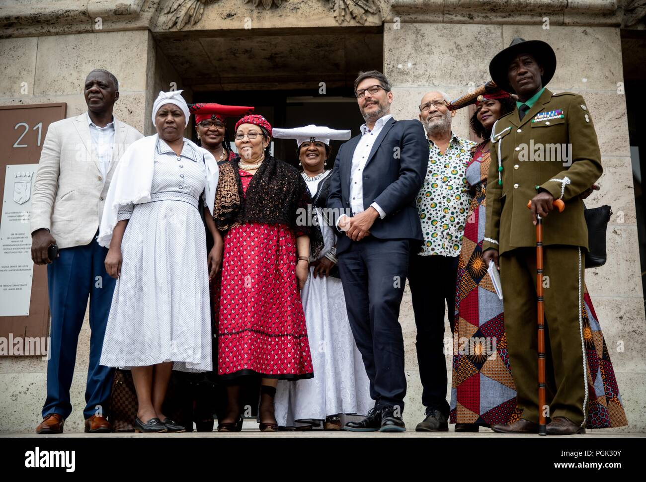 27 August 2018, Berlin, Germany: Dirk Behrendt (4th from right, Alliance 90/The Greens), Berlin Senator of Justice, receives a delegation of Ovaherero and Nama from Namibia, with Esther Utjiua Muinjangue (M), Chairwoman of the Ovaherero Genocide Foundation in Namibia, and Ida Hoffmann (4th from left).v.l), Member of Parliament and Chairwoman of the Nama Genocide Technical Committee in Namibia and other participants before the Senate Administration for Justice, Consumer Protection and Anti-Discrimination. This week, stolen remains of Herero and Nama murdered in the 1904-08 genocide are to be re - Stock Image