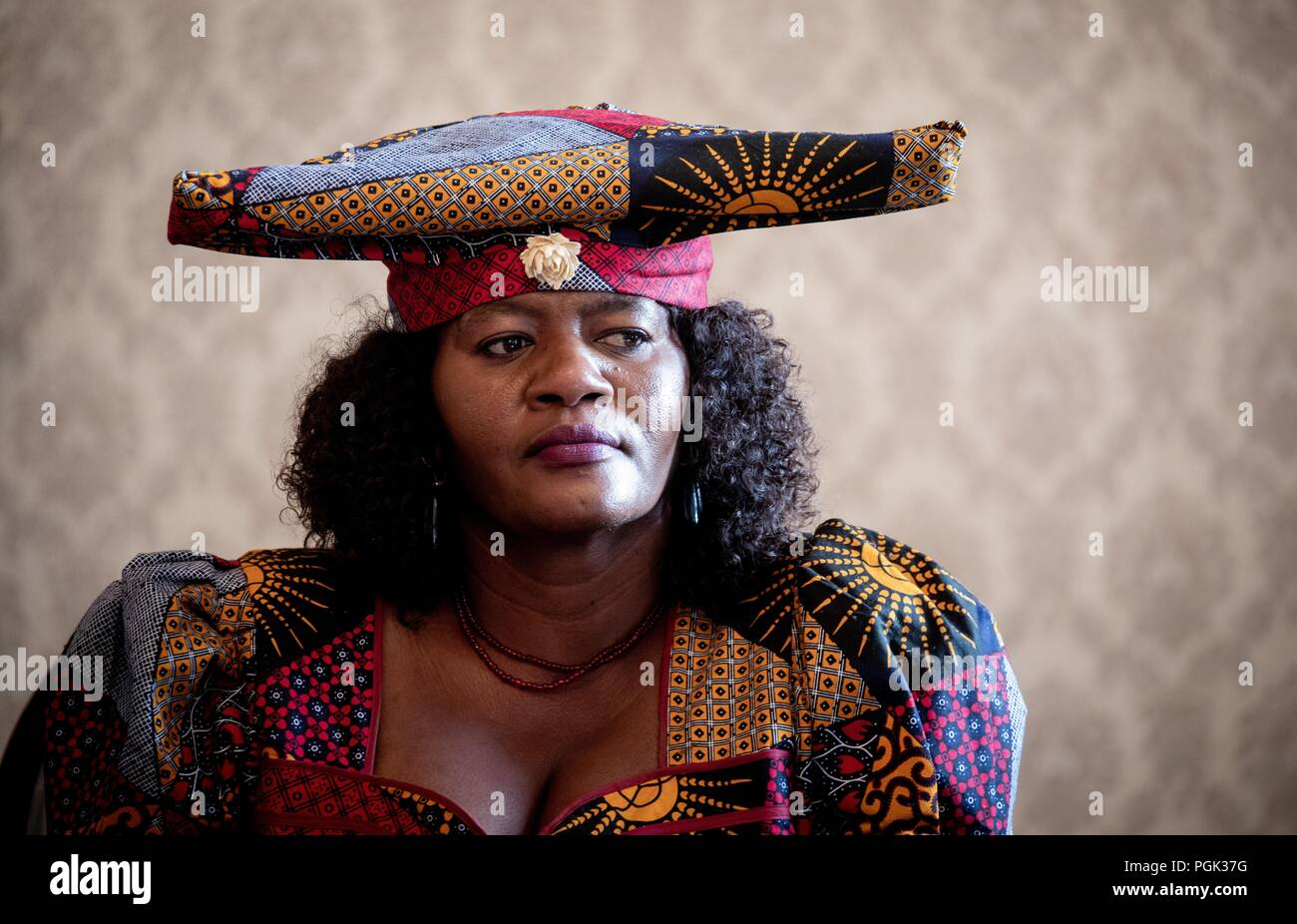 Germany, Berlin. 27th Aug, 2018. Erika Dasilla Kandurozu participates in a press conference as part of the delegation of Ovaherero and Nama from Namibia. This week, stolen remains of Herero and Nama murdered in the 1904-08 genocide are to be returned to a government delegation from Namibia. Credit: Kay Nietfeld/dpa/Alamy Live News - Stock Image