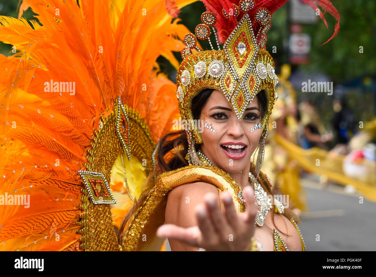 London, UK.  27 August 2018. A performer takes part in The Grand Finale parade at the Notting Hill Carnival.  Over one million revellers are expected to visit Europe's biggest street party over the Bank Holiday Weekend in a popular annual event celebrating Caribbean culture. Credit: Stephen Chung / Alamy Live News - Stock Image