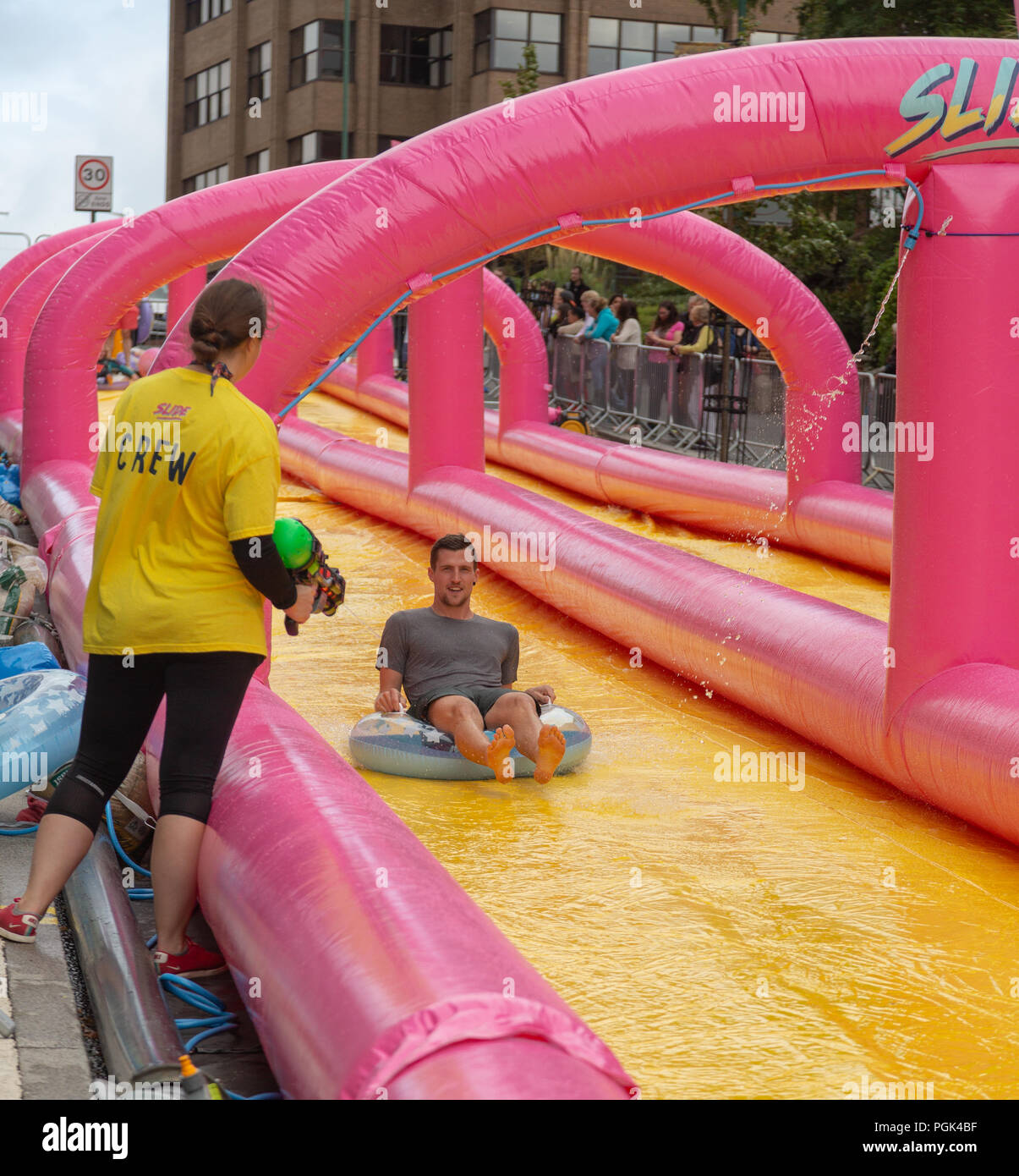 Inflatable Slide Bournemouth: Water Slide Children Stock Photos & Water Slide Children