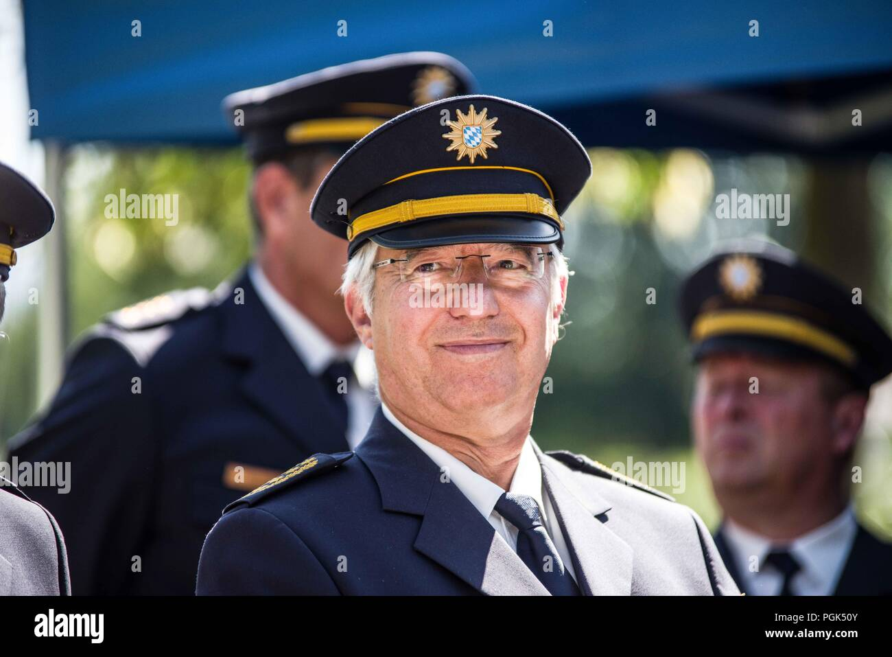 Freilassing, Bavaria, Germany. 27th Aug, 2018. WILHELM SCHMIDBAUER, Bavarian Police President. German Interior Minister HORST SEEHOFER and Bavarian Interior Minister JOACHIM HERRMANN made appearances at the Freilassing Saalbruecke border crossing between Germany and Austria to discuss the results of the newly-formed Bavarian Grenzschutzpolizei (Border Protection Police).Despite this, the Federal Pol - Stock Image