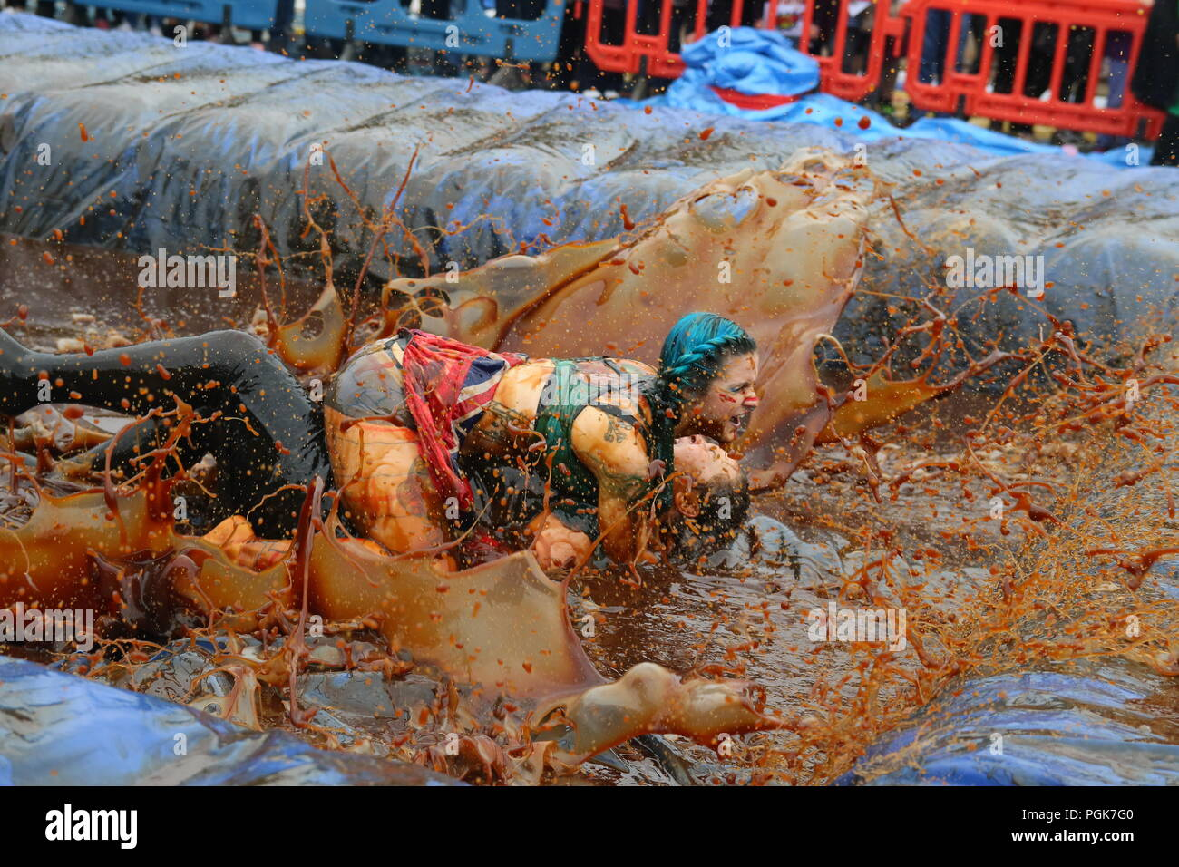 Stacksteads, Bacup, Lancashire, UK. 27 August 2018.The  World Gravy Wrestling Championships at the Rose 'n Bowl, Stacksteads to raise funds for the East Lancashire Hospice and competitors nominated charities.     A wild and whacky wrestling competition in a 16,000 litre pool full of Lancashire Gravy! All our contestants get sponsorship and really give it their all to raise Credit: Phil Taylor/Alamy Live News - Stock Image