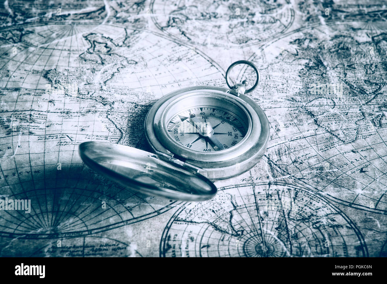old map of the world and antique brass compass Stock Photo