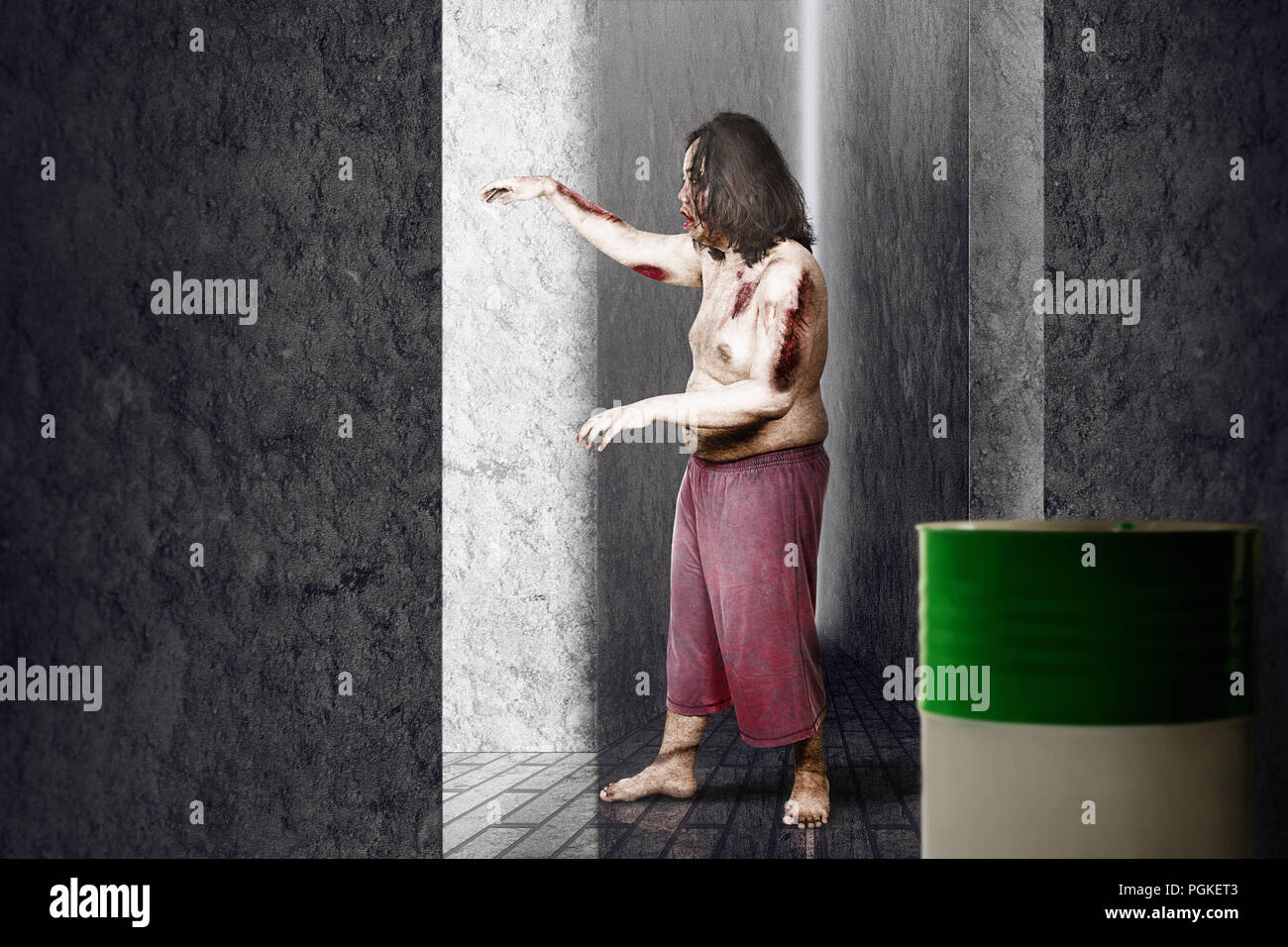 Side view of zombie man with wounds hanging around on abandoned place Stock Photo
