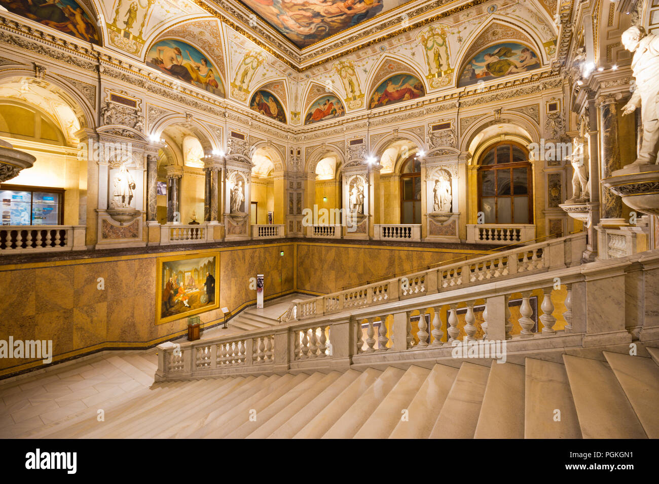 Sumptuous staircase with statues and round arches in imposing interior of famous Naturhistorisches Museum (natural history museum) in Vienna old town. - Stock Image