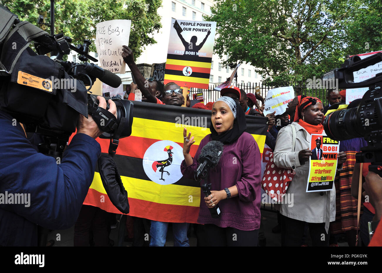 Zuhuru Yanus (BBC Presenter/Producer/Reporter, Swahili TV + World Service) presenting from a protest in Whitehall in support of Bobi Wine (Nigerian po - Stock Image
