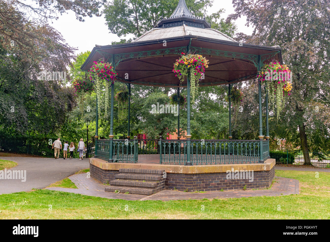 Hanging baskets decorating a bandstand in a park in Great Malvern, Worcestershire, England, UK - Stock Image