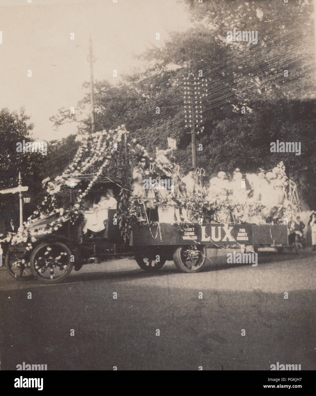 Vintage Photograph of a Carnival Float With a Lux Advert on The Side of The Lorry. Signpost For Greensford Next To The Lorry. - Stock Image