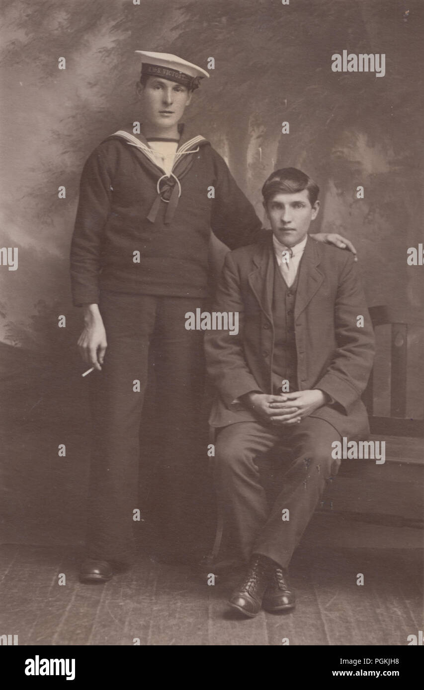 Vintage 1917 Studio Photographic Postcard of a H.M.S.Victory Sailor and Possibly His Brother - Stock Image