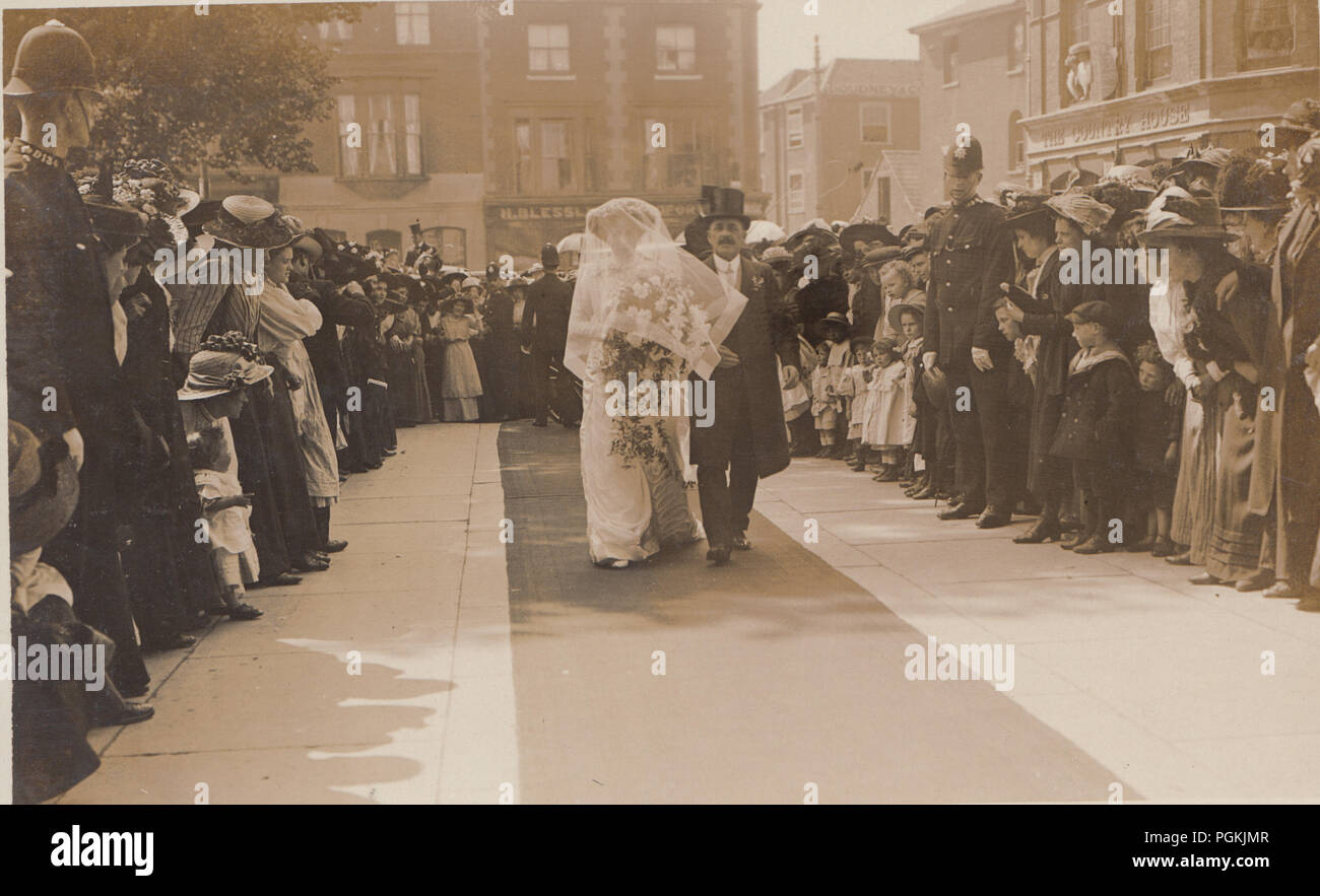 Vintage Portsmouth Photographic Postcard of a High Society Wedding With Police Maintaining The Crowds of People - Stock Image