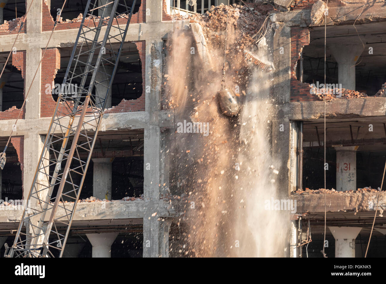 Rock Island, Illinois - Workers use a wrecking ball to demolish the Rock Island Plow Company building. Subsequently used by J.I. Case, the building ha - Stock Image