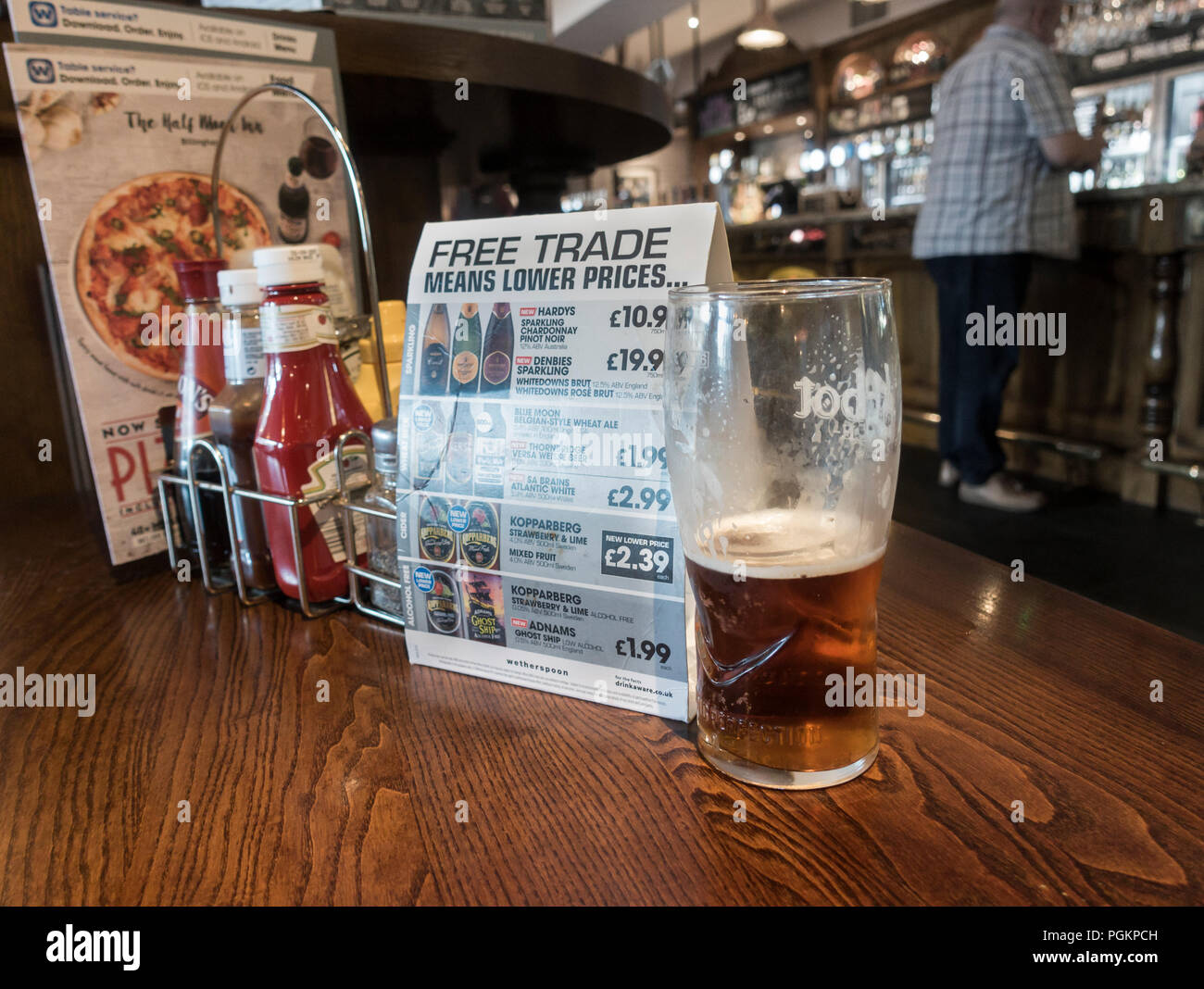"""""""Free trade (post Brexit) means lower prices"""" info in JD Wetherspoons pub in England. UK Stock Photo"""