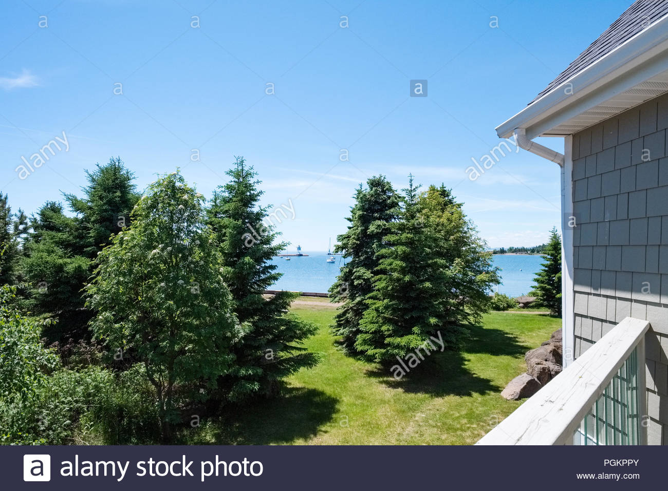 View of Grand Marais harbor from the balcony of a Cobblestone Cove condominium - Stock Image