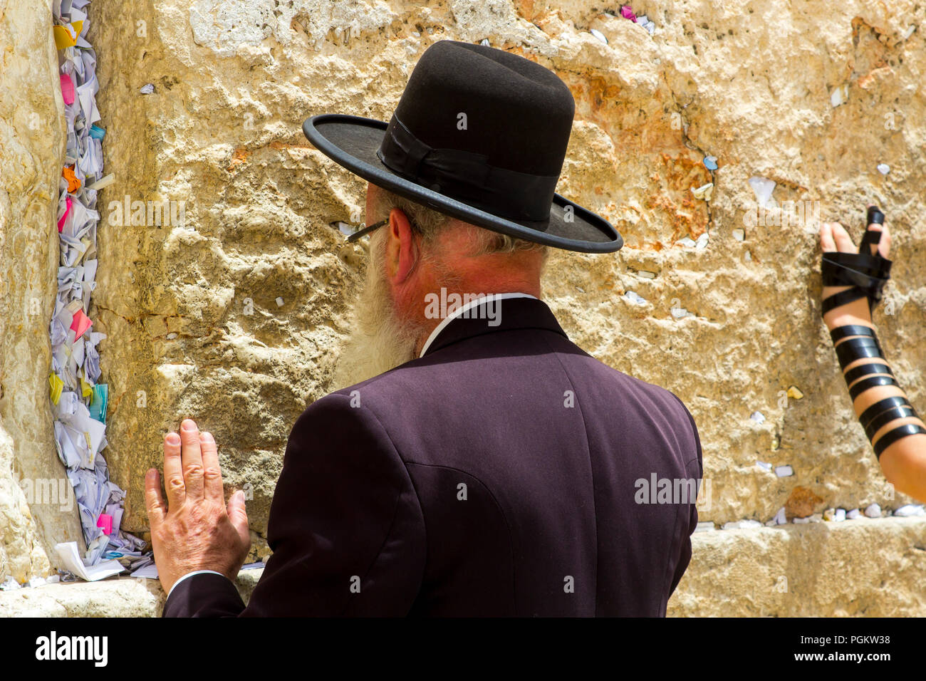 10 May 2018 An orthodox Jewish male at prayer  before the ancient Western Wall on the Temple Mount in Jerusalem Israel - Stock Image