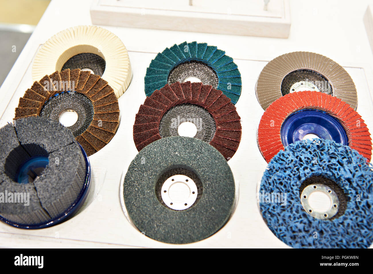 Grinding and polishing disc for angle grinder in store - Stock Image