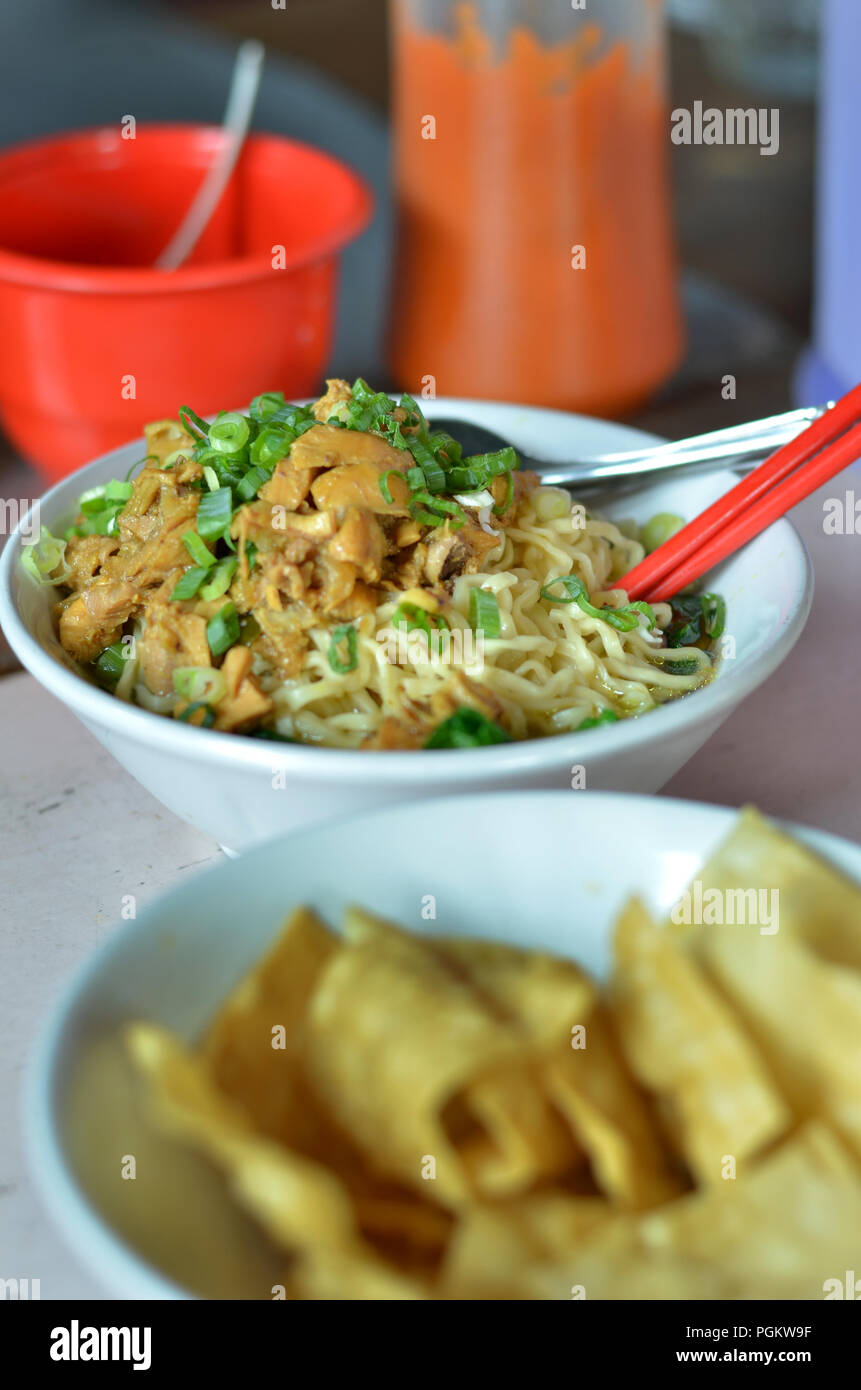 Indonesian street food, a bow of noodle with chiken , Mie Ayam - Stock Image