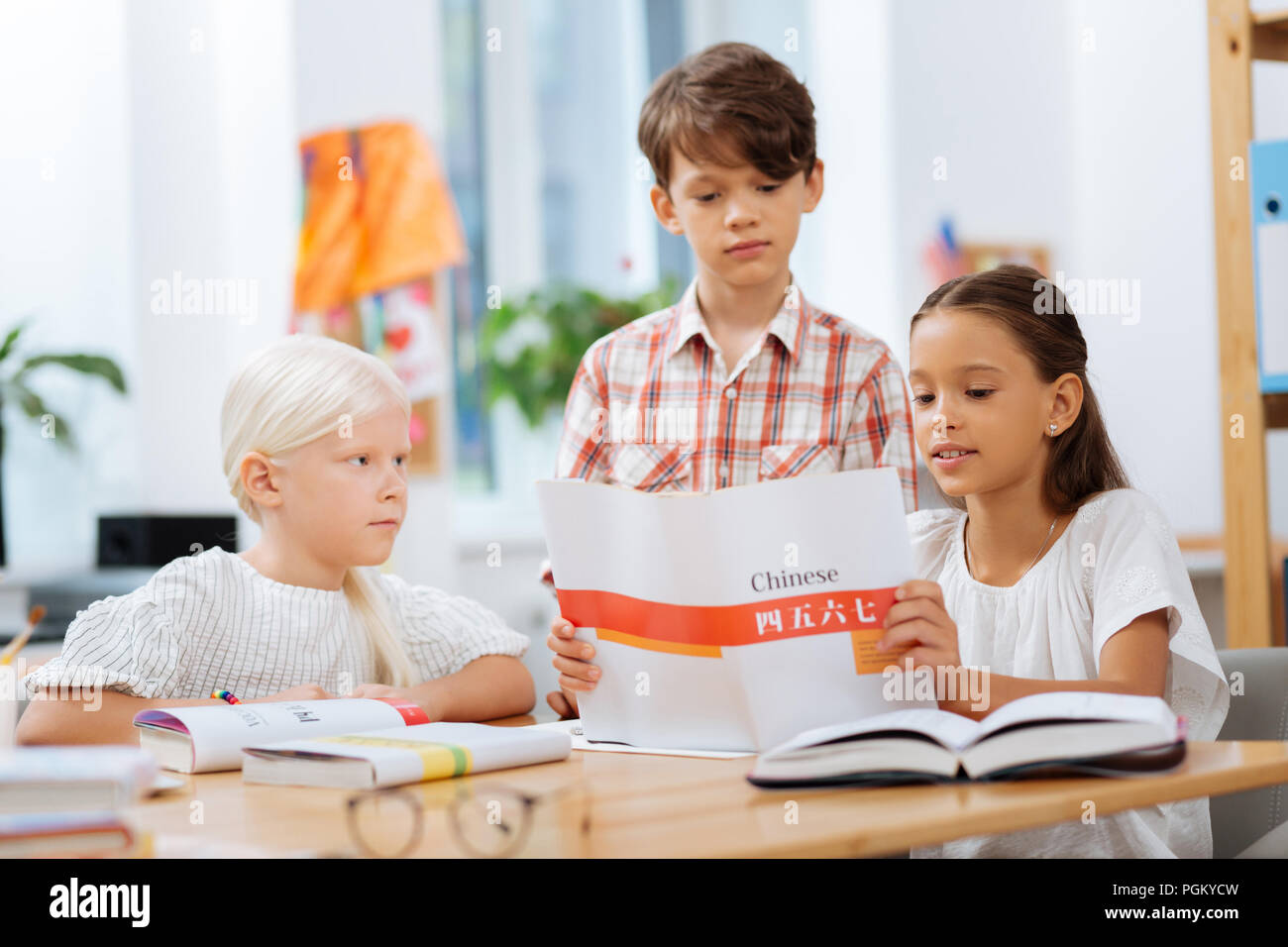Concentrated children paying attention on details in an exercise - Stock Image