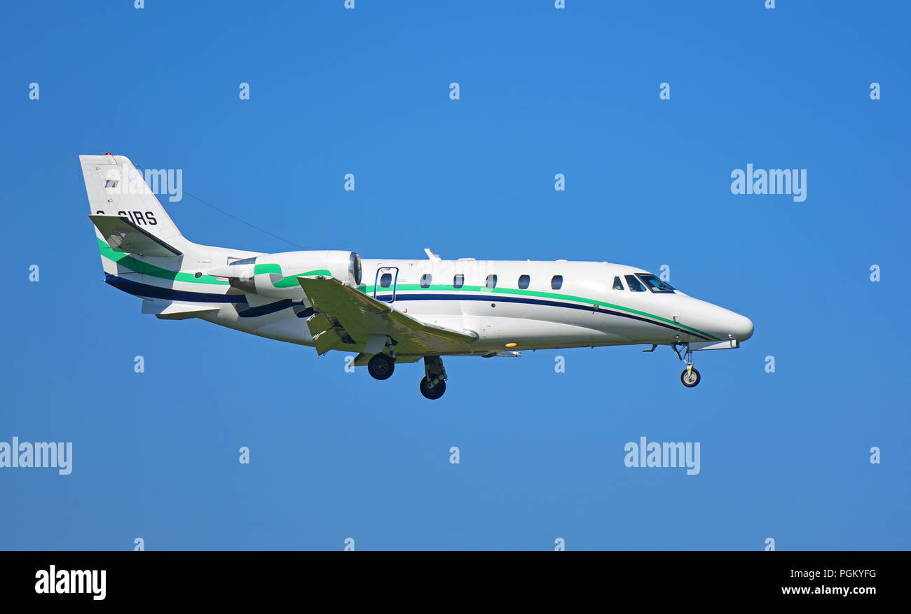 A Cessna Citation XL arriving at Inverness Airport on a gentle glide slope approach is this Cessna 560XL Citation twin jet - Stock Image