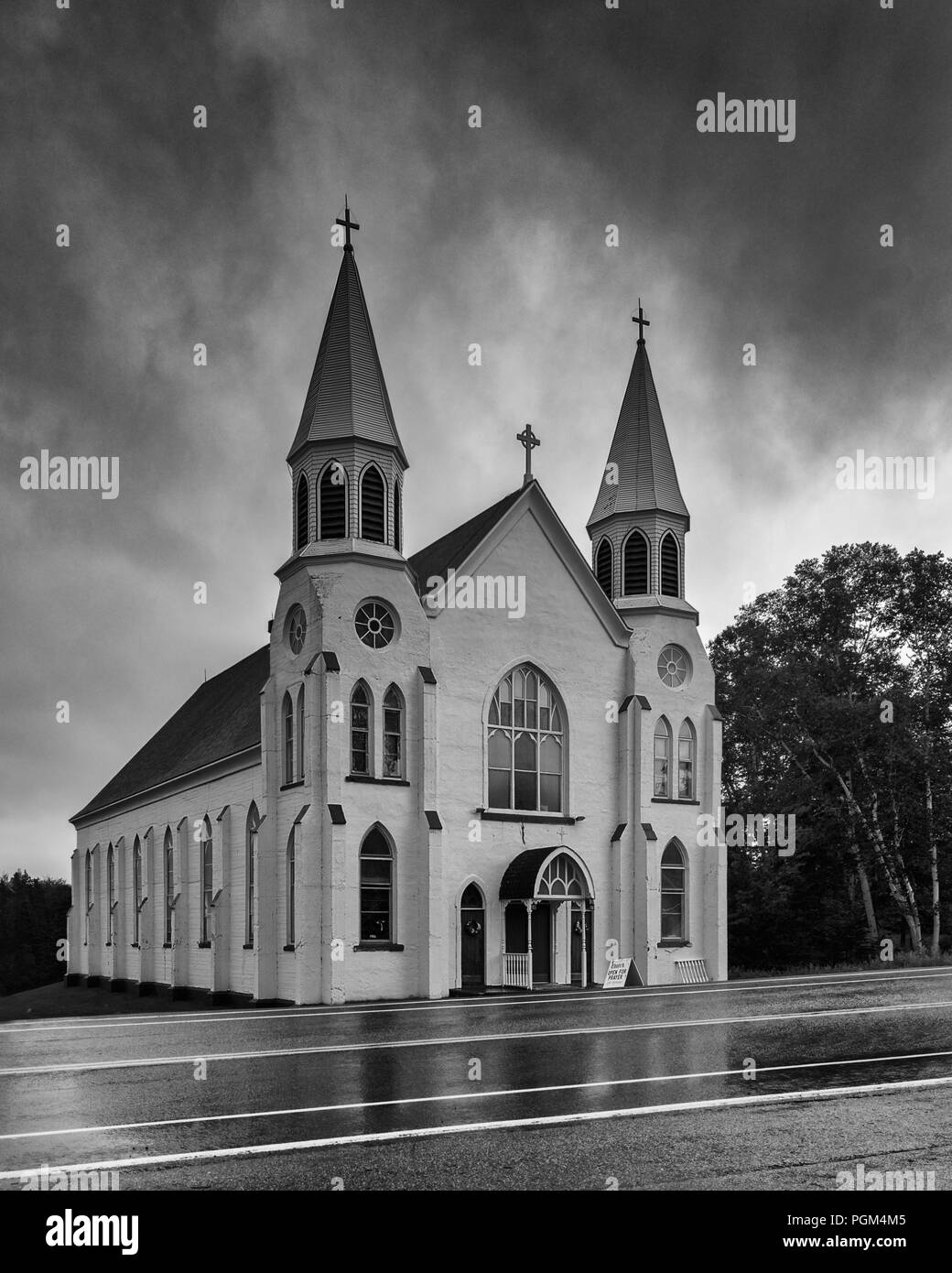 Exterior of the St. Peter's Roman Catholic Church on Cabot Trail on a rainy afternoon in Ingonish Beach, Nova Scotia - Stock Image
