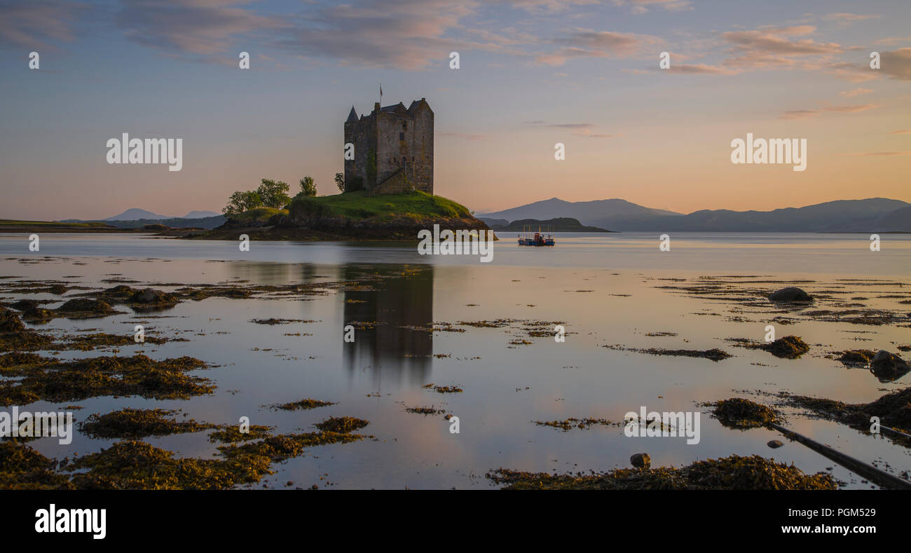 Stalker Castle in the evening. Scotland, Great Britain. Long exposure photography. - Stock Image