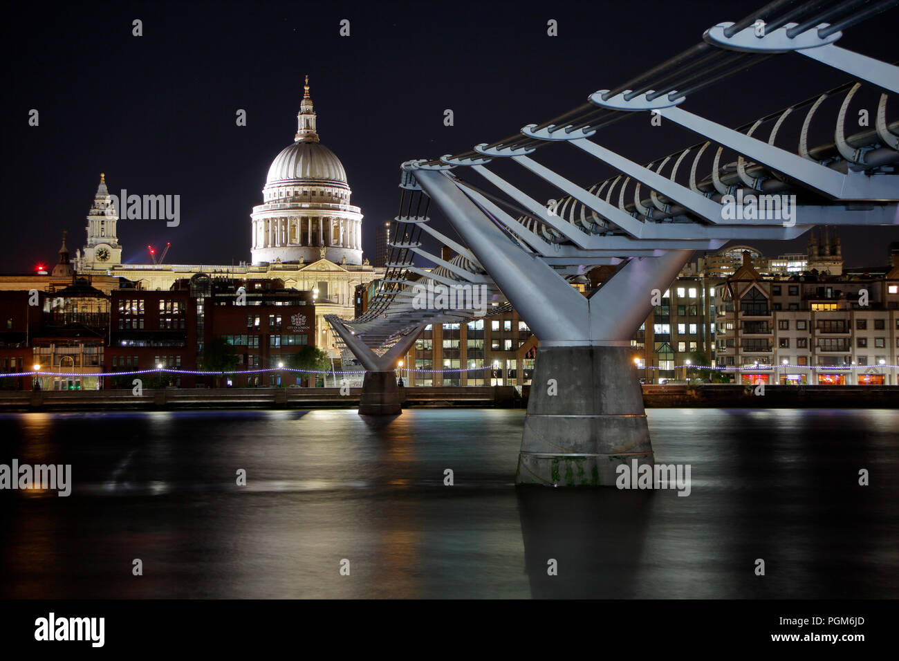 Saint Pauls Cathedral and The Millennium Bridge, London, at night - Stock Image