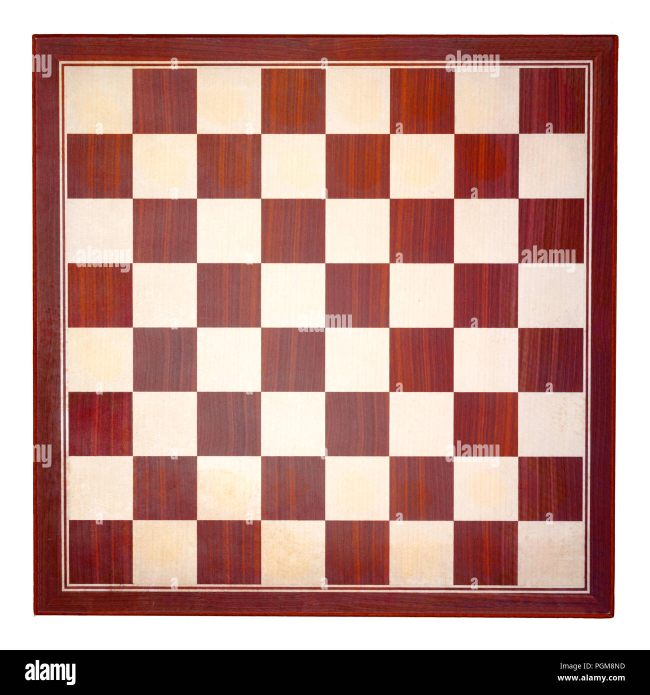 top view of brown and tan wooden chessboard on white square background - Stock Image