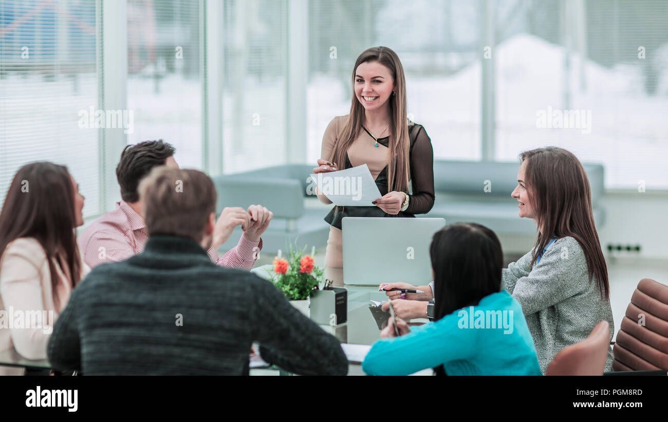 Manager conducts the presentation of the new advertising project of the company in the spacious office - Stock Image