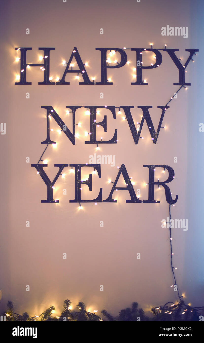 Happy new year holiday bright words on the wall wall decor in the night
