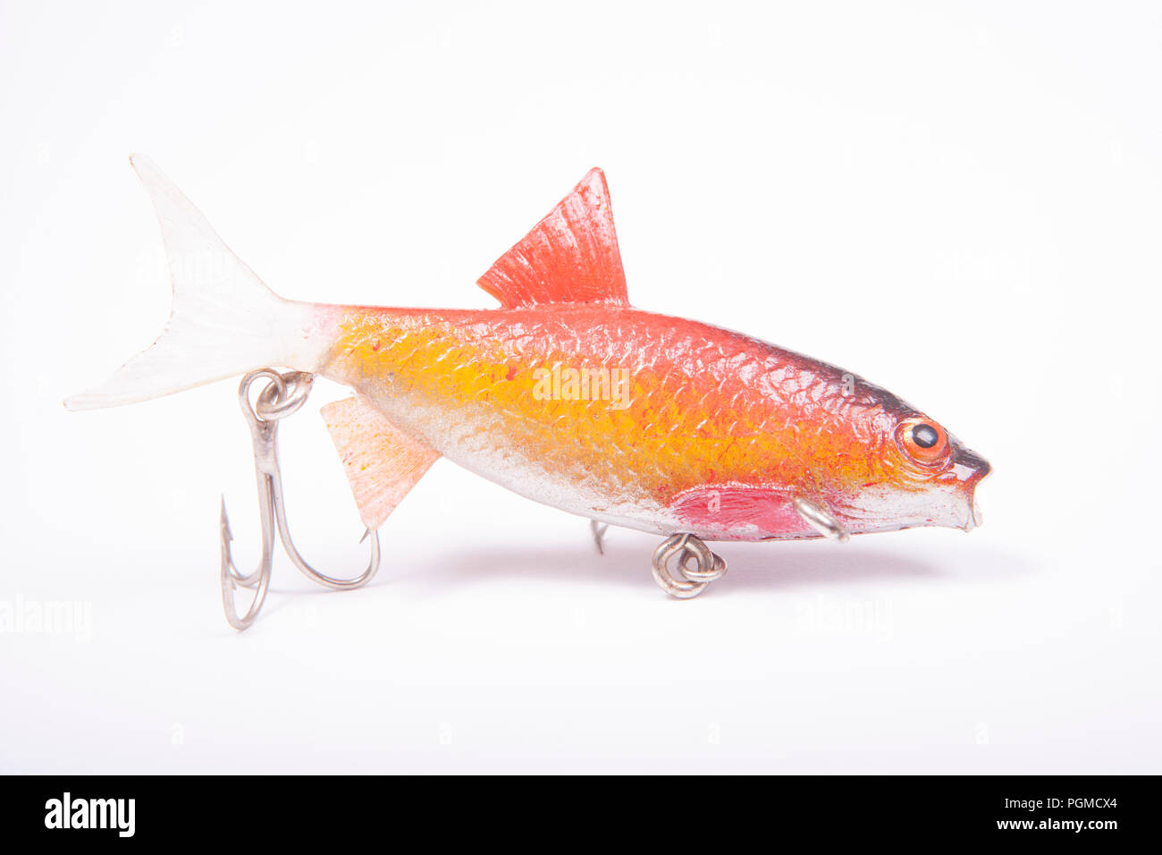 A lifelike fishing lure equipped with treble hooks for catching predatory fish. From a collection of vintage and modern fishing tackle. North Dorset E - Stock Image