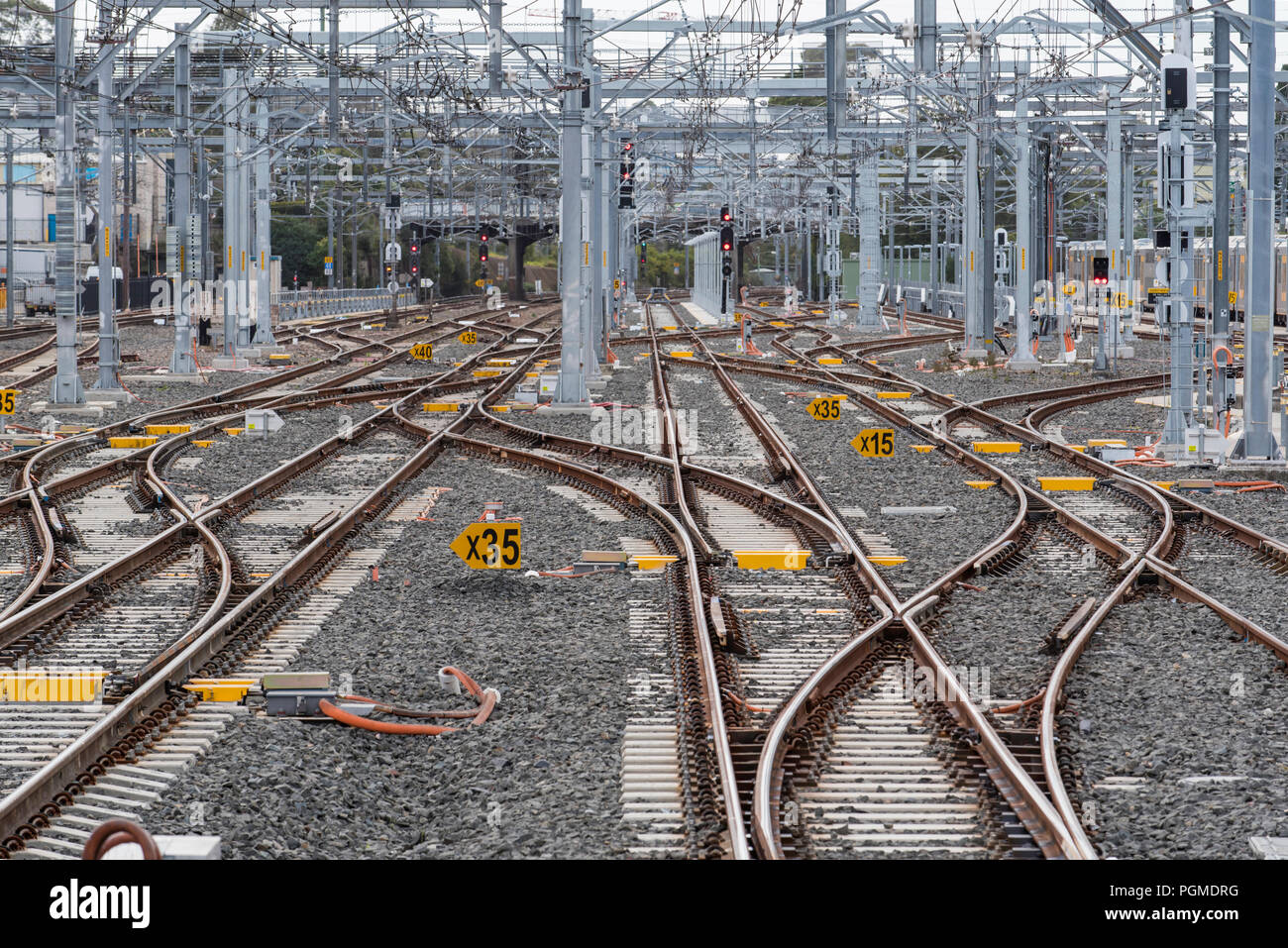 A network of intersecting railway lines or tracks at the end of Hornsby Railway station that lead north to stabling yards and other network stations - Stock Image