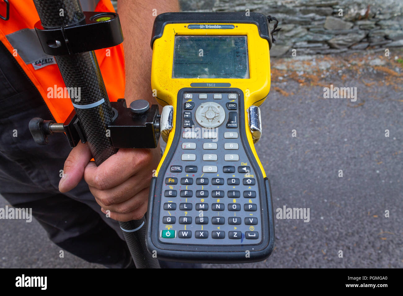 land surveyor holding a trimble global positioning system controller. - Stock Image