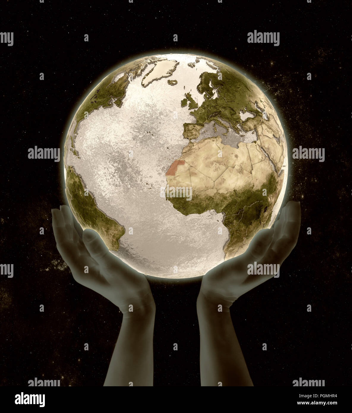 Western Sahara on globe in hands in space. 3D illustration. - Stock Image
