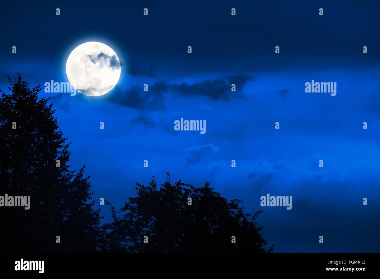 magic full moon at the night sky - Stock Image