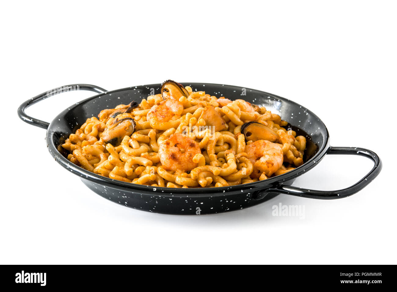 Traditional Spanish fideua. Noodle paella isolated on white background. - Stock Image