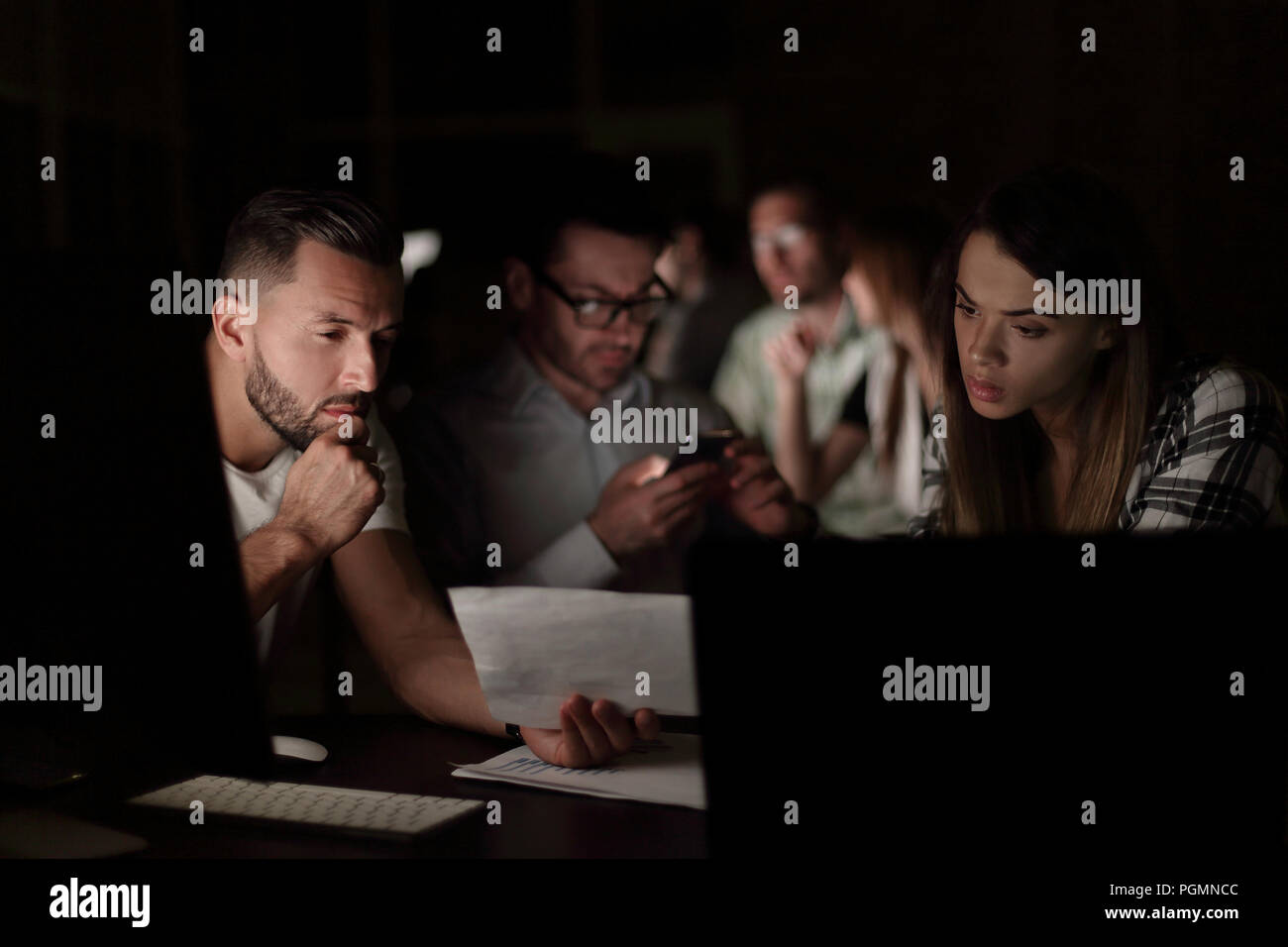 business team uses gadgets to solve the problem - Stock Image