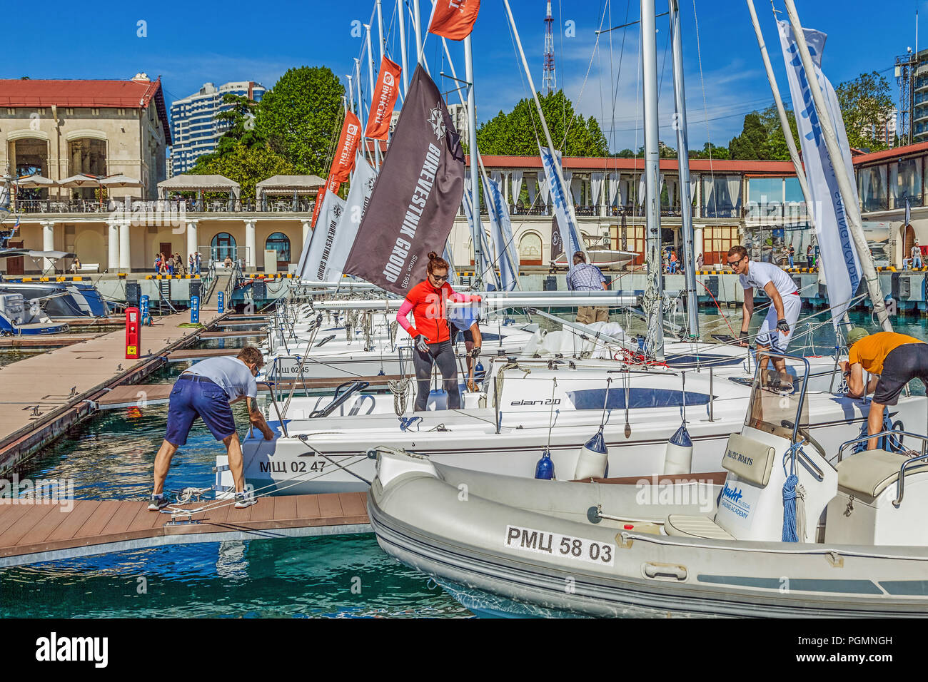 SOCHI, RUSSIA - MAY 21, 2016: Yachtsmen on the pier. - Stock Image