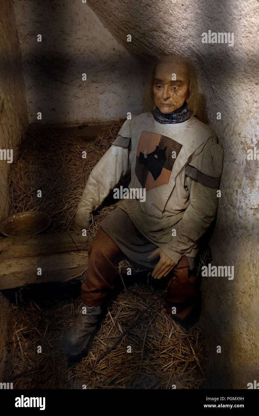 Diorama showing medieval soldier in prison cell / dungeon in the Château de Bouillon Castle, Luxembourg Province, Belgian Ardennes, Belgium - Stock Image
