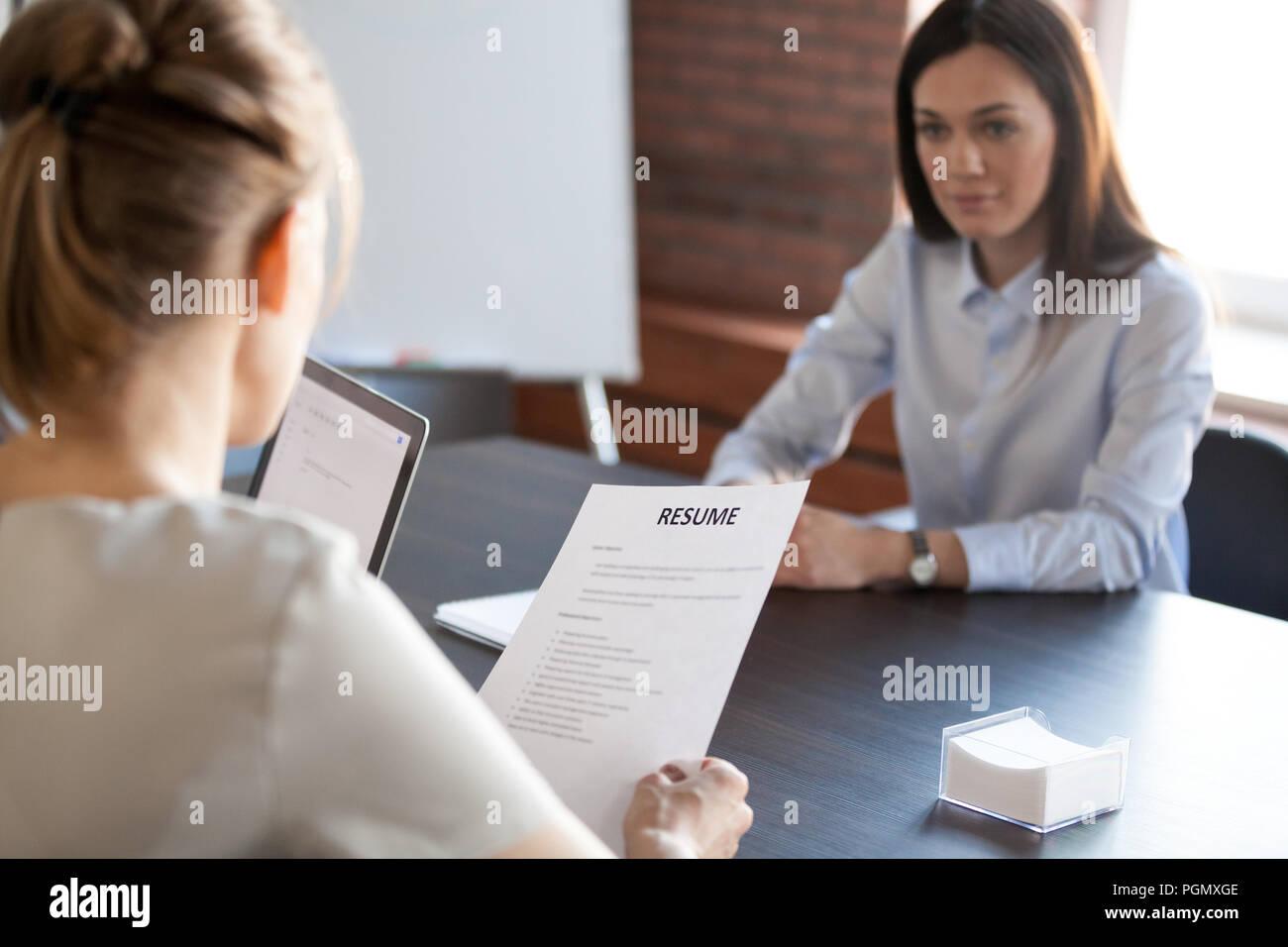 HR mangers hiring millennial female job candidate - Stock Image
