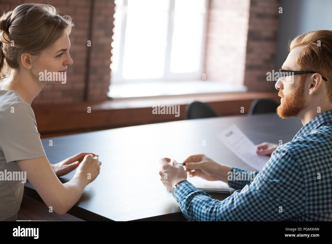 Recruiter considering female applicant candidature during interv - Stock Image
