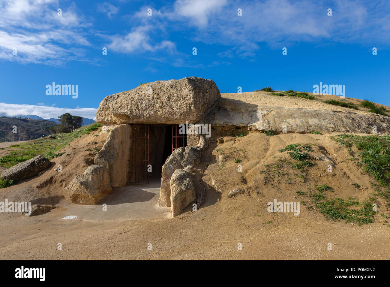 The Dolmen de Menga is in the Spanish town of Antequera (Málaga). It is a covered gallery dolmen and almost rectangular plant, dating from the 3rd mil - Stock Image