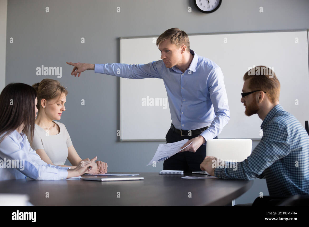 Mad male ceo ask female worker leave company meeting Stock