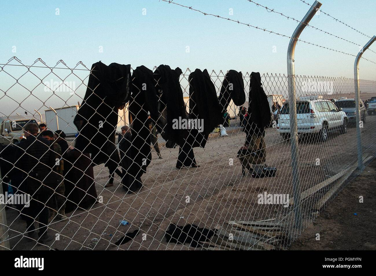 A refugee camp in Iraq, where live people escaped from ISIS. Niqabs abandoned by the women forced to bring under the Caliphate. Stock Photo