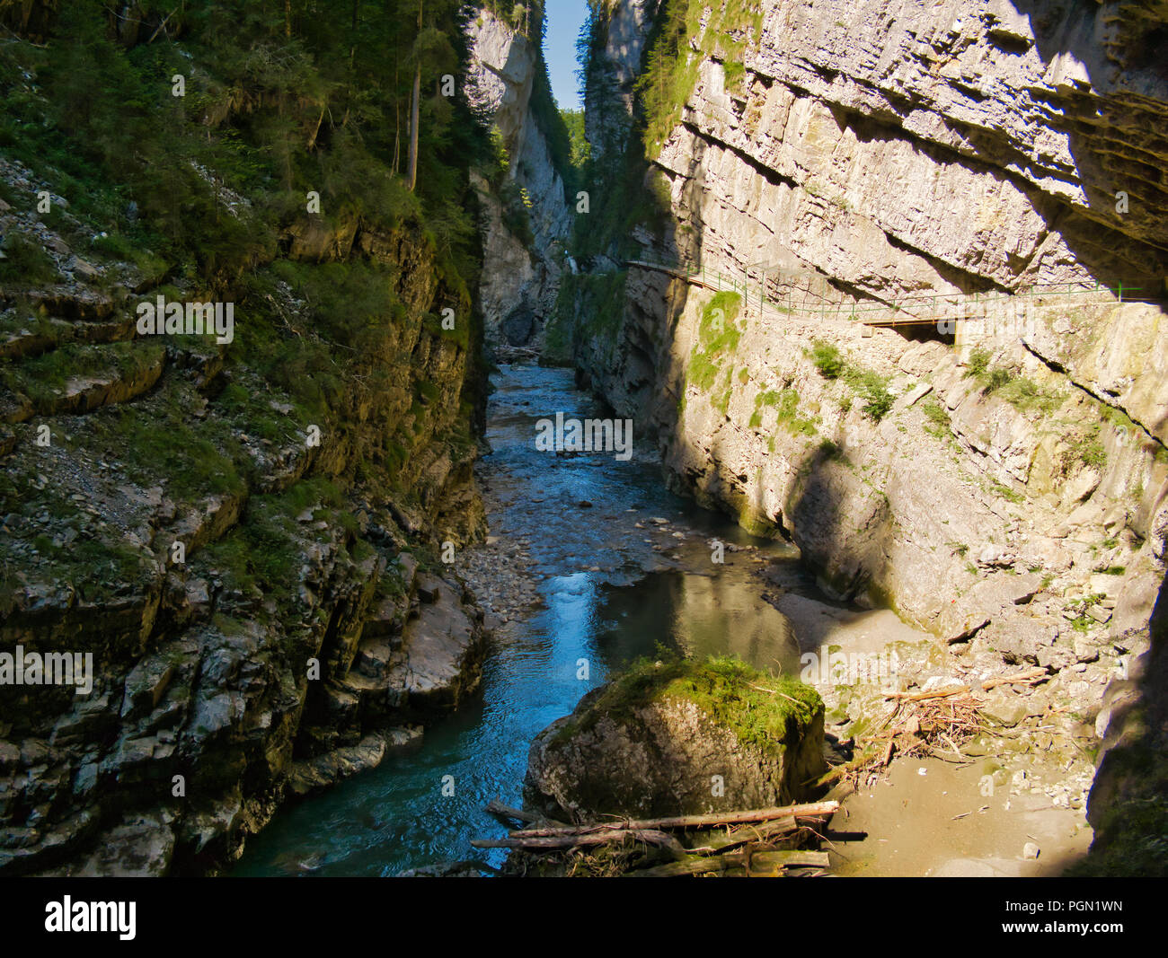 Entrance from the south side to the gorge in sunshine with little water in summer - Stock Image