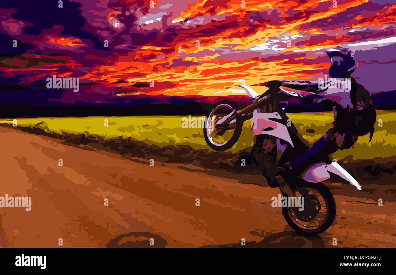 Popping a wheelie during sunset. - Stock Image