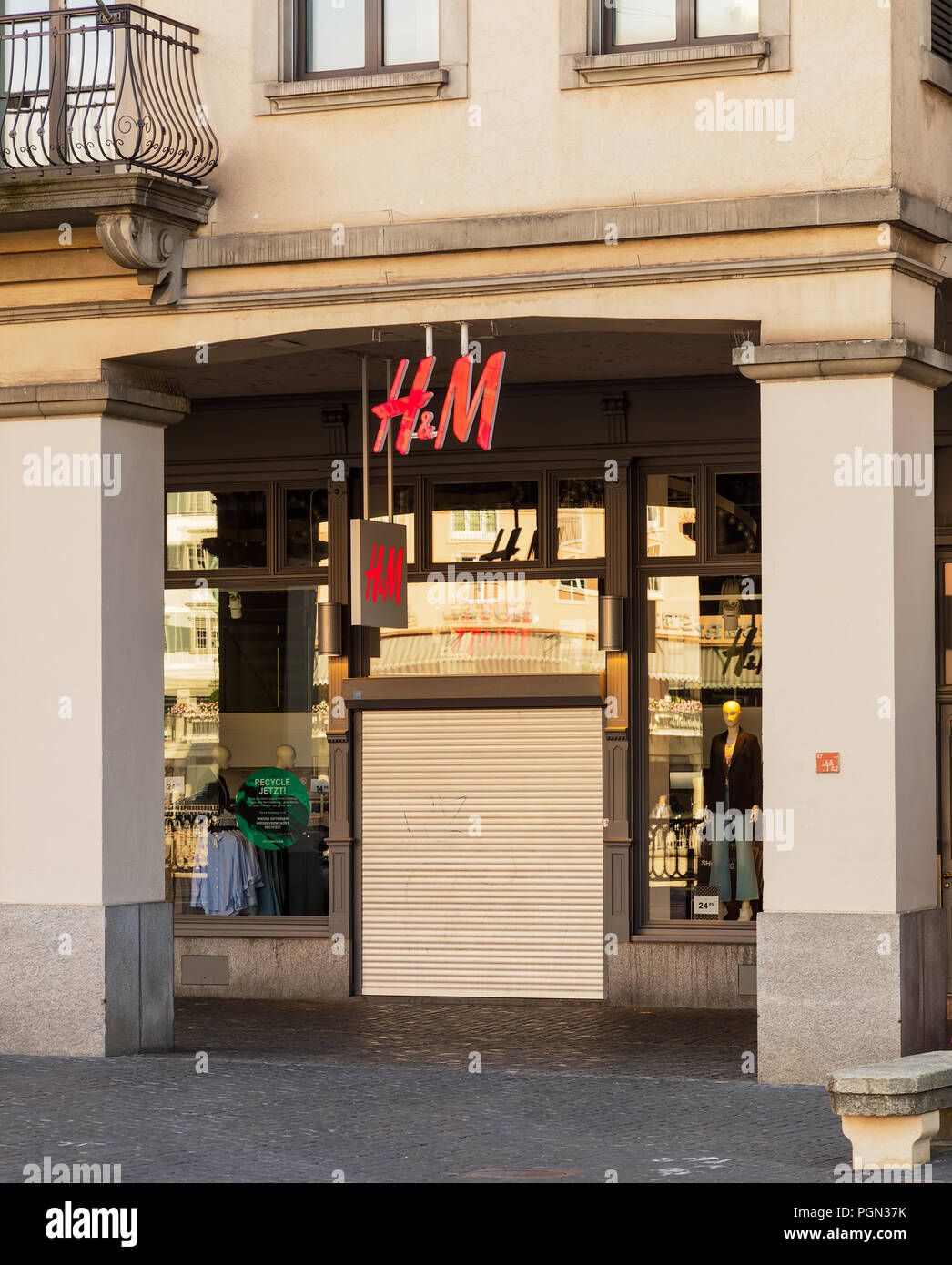 Entrance to the closed on Sunday H&M store on Limmatquai quay in Zurich, Switzerland. - Stock Image