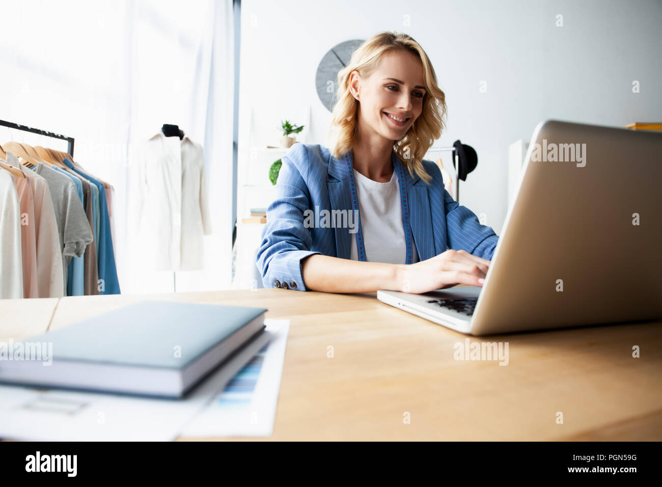 Fashion designer working on her designs in the studio - Stock Image