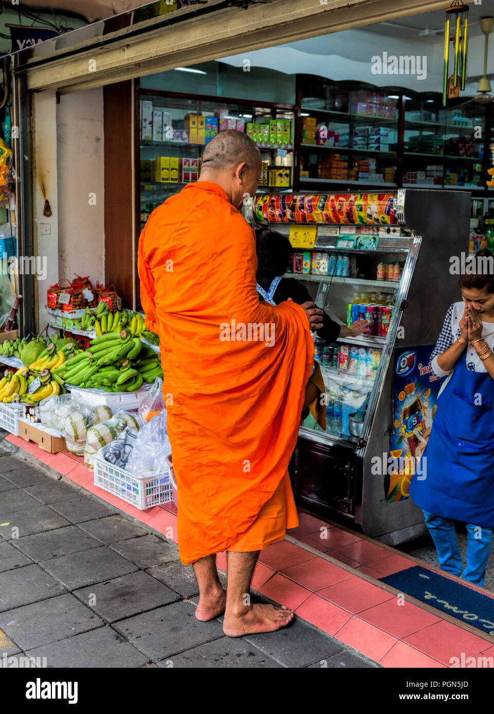Buddhist Monk receiving alms and giving a blessing Bangkok Thailand - Stock Image
